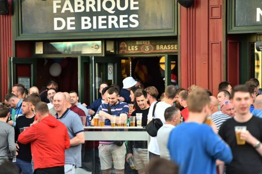 "Customers, tourists and footbal fans drink beer at the terrace of a bar in Lille, northern France, on June 14, 2016. The bars in downtown Lille will be closed ""at midnight"" on June 15 and 16, on the sidelines of the  Euro 2016 football tournament matches Russia vs Slovakia in Lille and England vs Wales in Lens, has announced on June 14, 2016 the Prefect of the Nord region, Michel Laland. / AFP / PHILIPPE HUGUEN        (Photo credit should read PHILIPPE HUGUEN/AFP/Getty Images)"